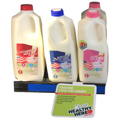 milk with shelf talker displaying which is the healthy choice