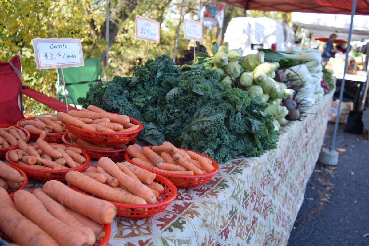 carrots and kale at farmer's market