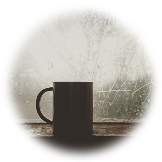 Coffee by window on a snowy day