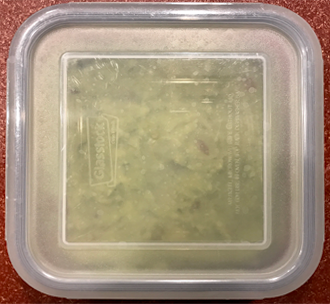 guacamole in a container with a tightly fitting lid