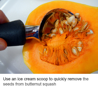 Removing the seeds from a butternut squash with an ice cream scoop