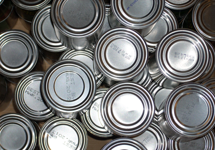 several tin cans without the labels