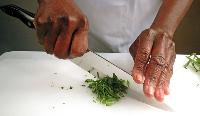 Chopping small bunches of herbs