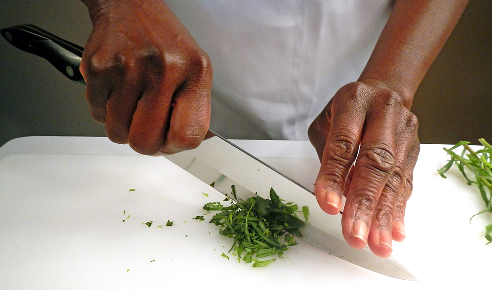 person cutting herbs