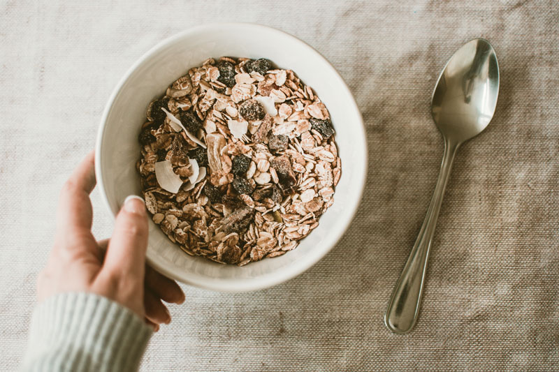 Person holding a bowl full of oats