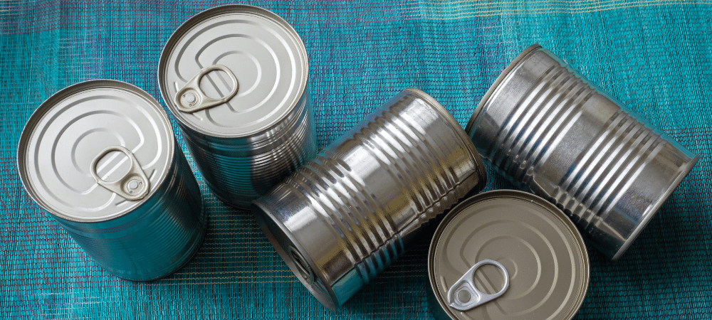 group of canned food on a table