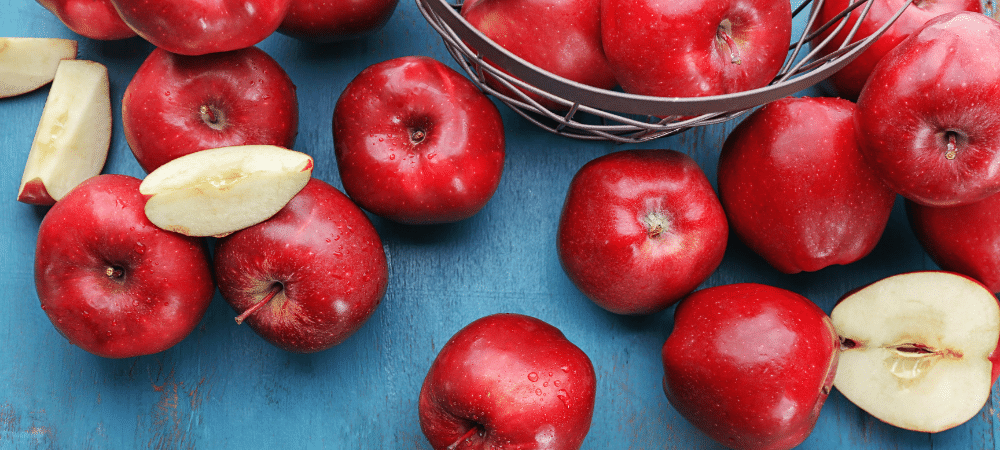 red delicious apples on table