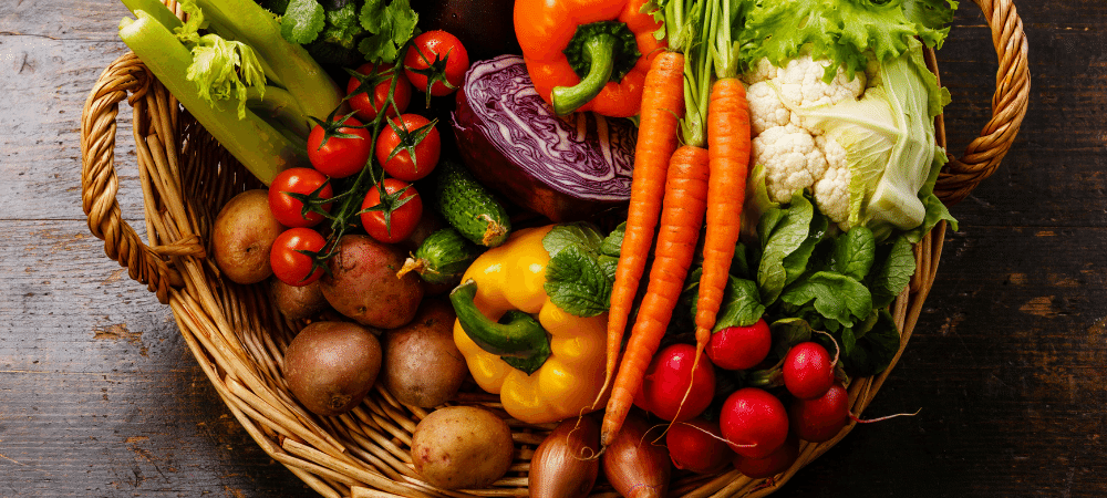variety of fresh vegetables in a basket