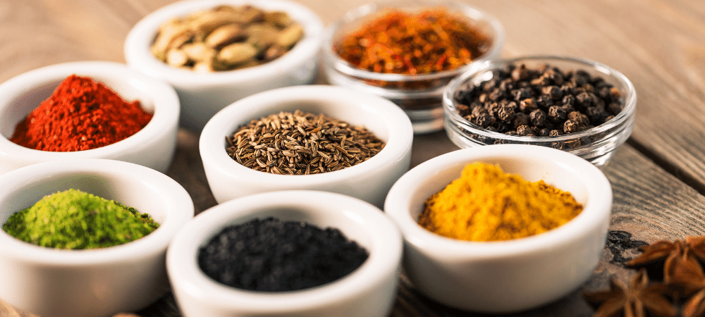 variety of herbs and spices in bowls