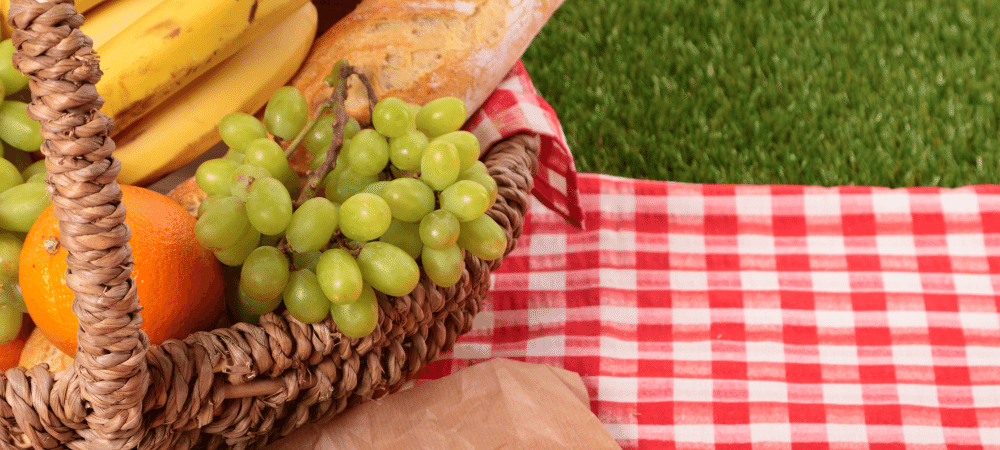 basket of fruit and bread for a summer picnic