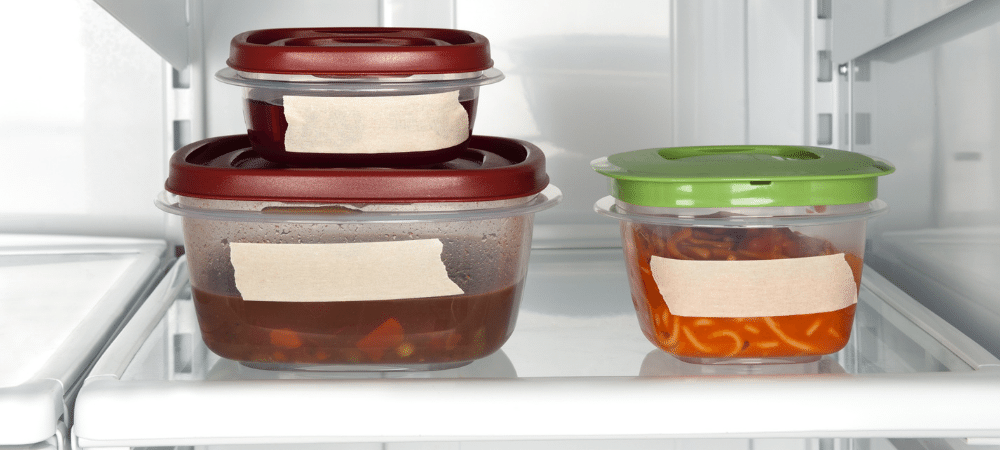 leftovers in food storage containers in the refrigerator