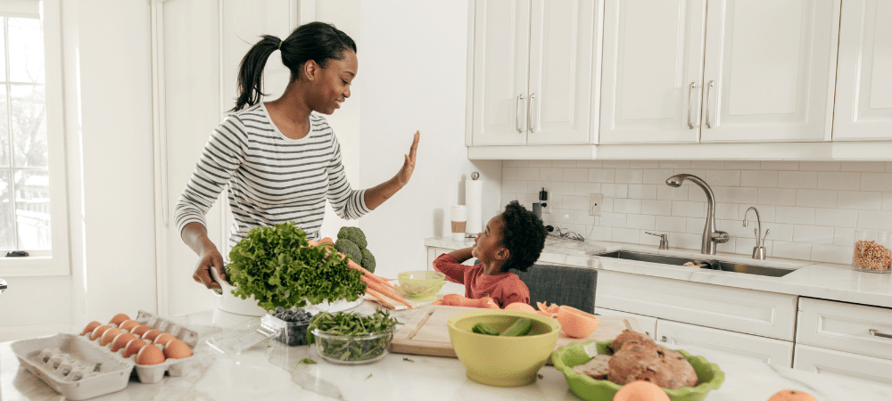 mom and child cooking in the kitchen