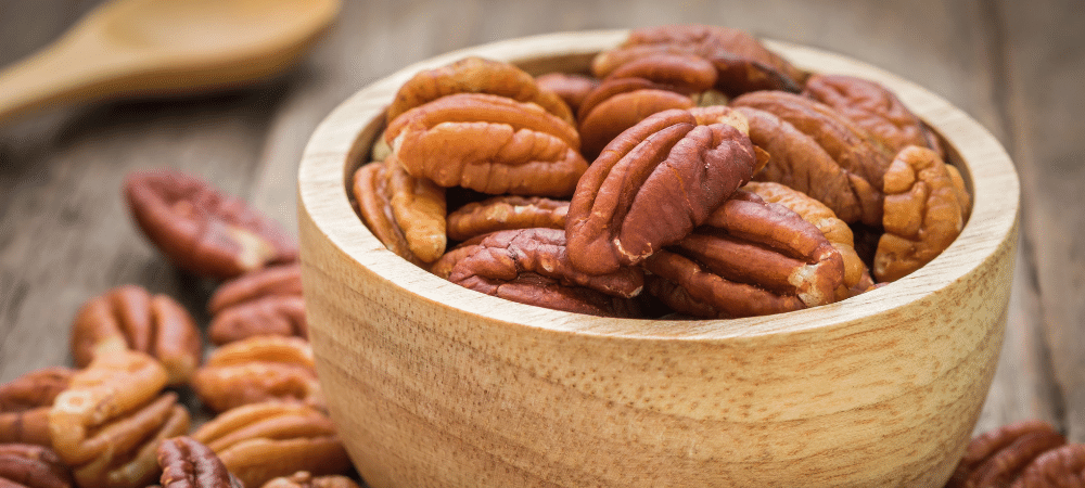 pecans in a bowl on a table