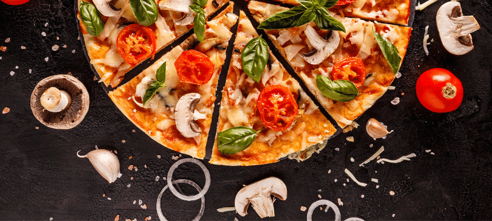 Italian pizza with mushrooms, tomatoes, onion, and basil