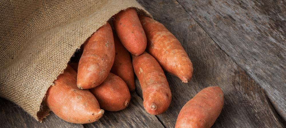 sweet potatoes in a burlap sack
