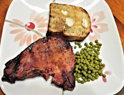 plate with bread, meat and peas