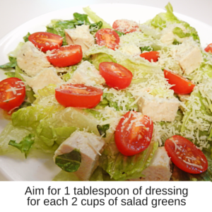 2 cups of salad with 1 tablespoon of dressing