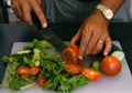 man making salad as part of June Food Theme Month Calendar, National Men's Health Week