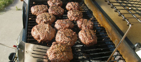 beef burgers on grill