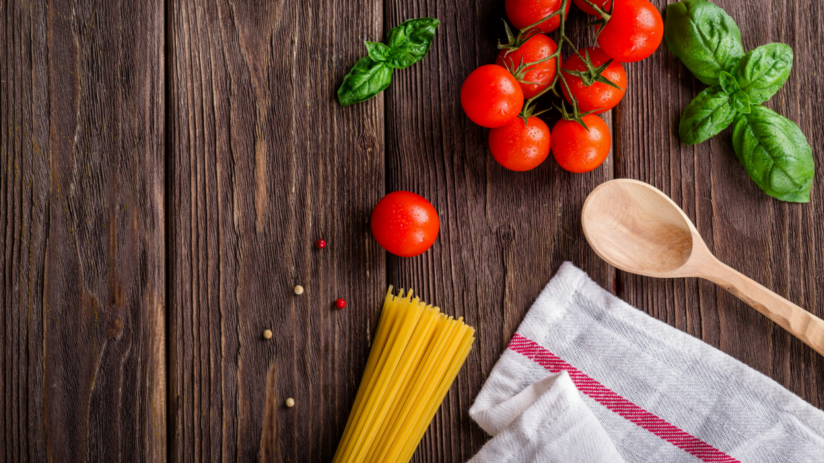 Cooking tomatoes and pasta in a kitchen