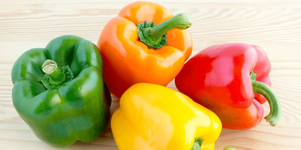 green, orange, red, and yellow bell pepper