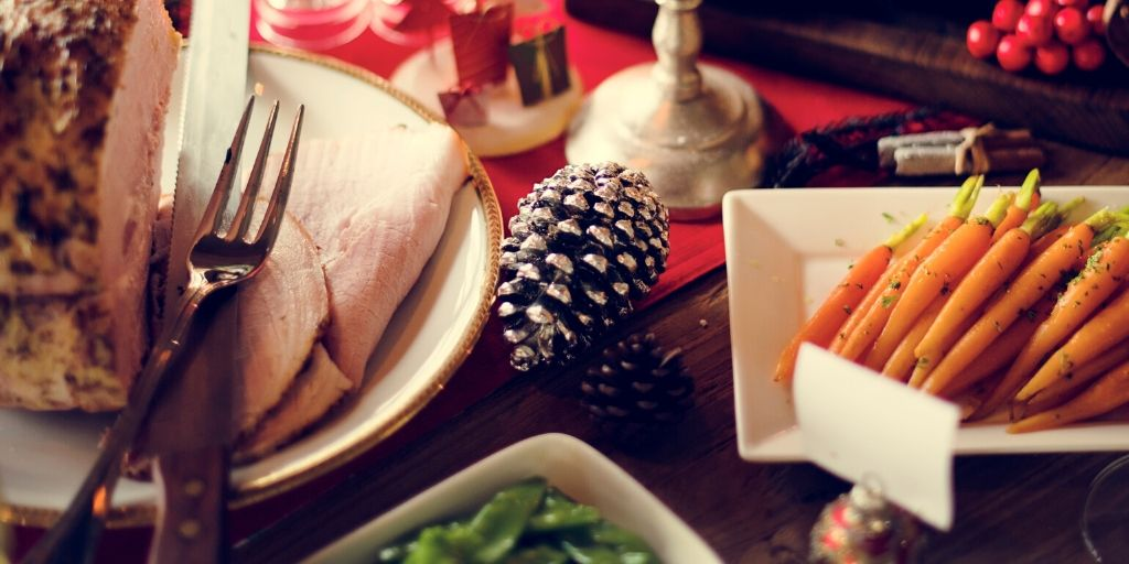 holiday dinner table with ham and carrots