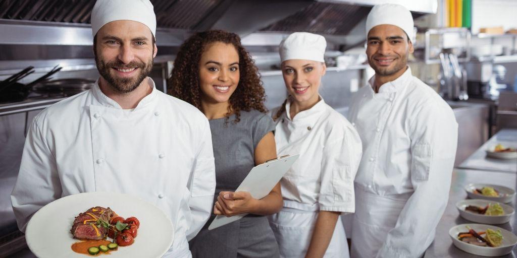 restaurant manager with kitchen staff