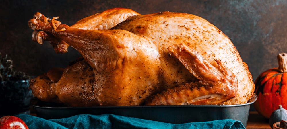 Roasted whole turkey in a pan