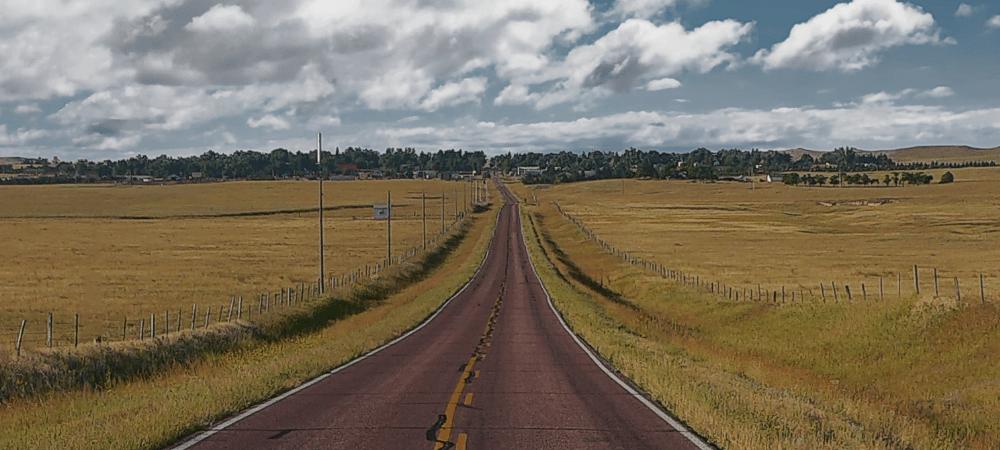 scenic road in Nebraska with fields on each side