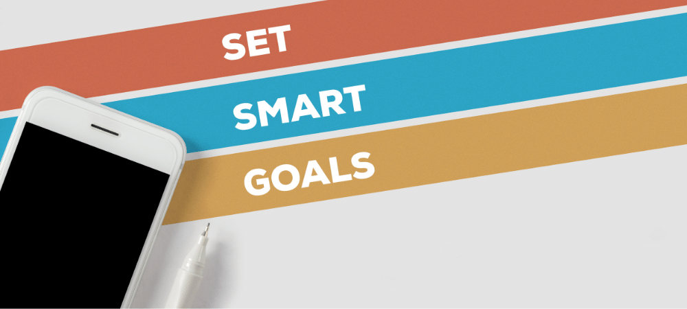 set smart goals by using a pencil or an electronic device