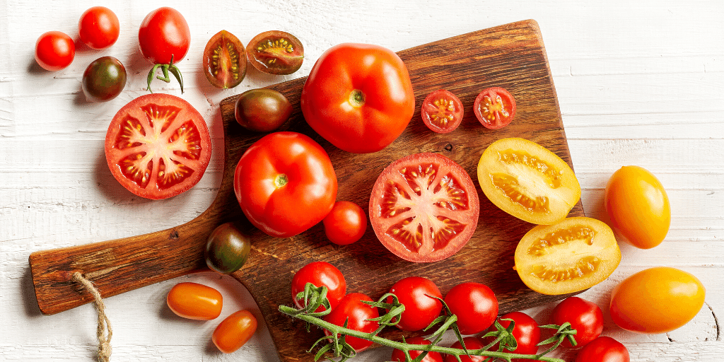 variety of colorful tomatoes on a cutting board