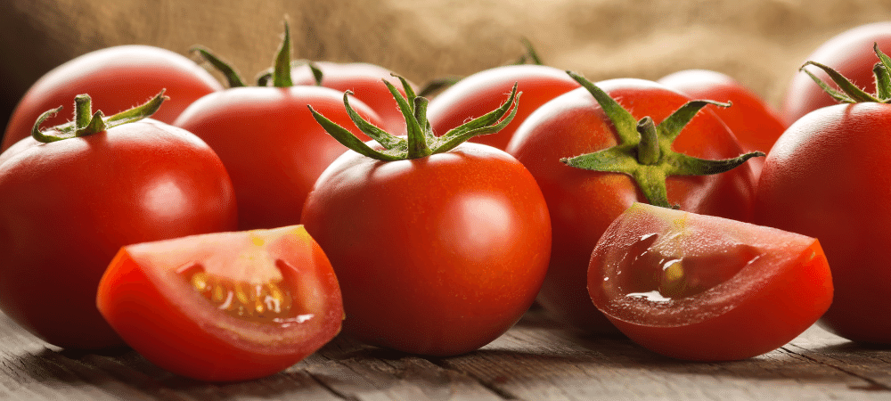 red tomatoes on a wooden table