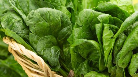 Close-up photo of spinach in a basket