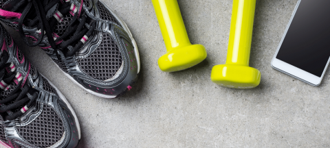fitness background with tennis shoes, dumbbells, and cell phone