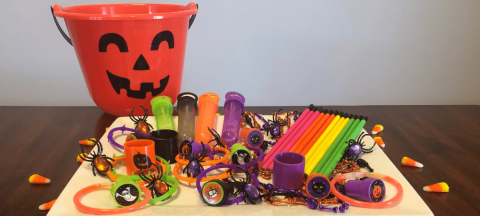 Halloween non-food treats such as pencils, stamps, bubbles, jewelry, etc.