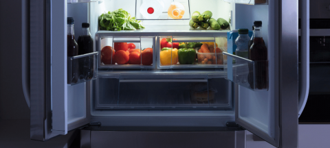 kitchen refrigerator open with produce
