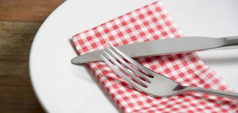 plate with napkin, fork, knife