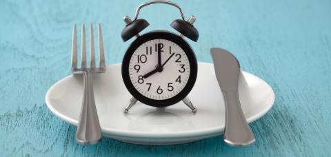 plate with a clock
