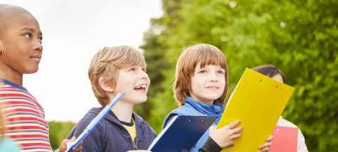 children play scavenger hunt with clipboards