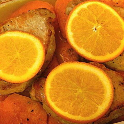 Orange slices, pork and potatoes
